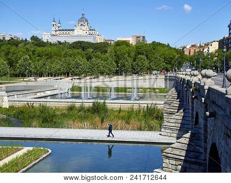 Madrid, Spain - May 15, 2018. Puente De Segovia Bridge Crossing The Gardens Of Madrid Rio At Spring