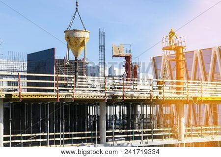 Construction Crane Tower On Blue Sky Background. Crane And Building Working Progress. Worker. Empty