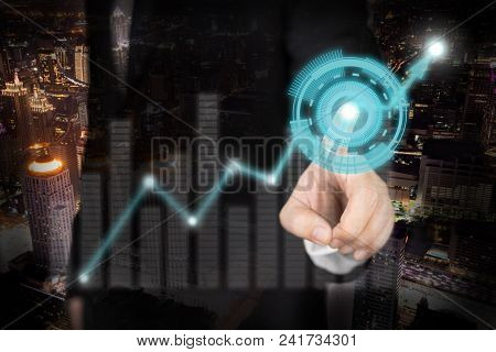 Double Exposure Of Businessman With Digital Stock Market Concept On The Cityscape Background.