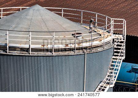 View Of Big Metal Grain Storage Unit. Industrial Concept