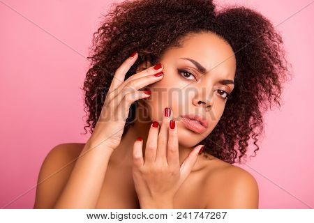 Close Up Of Pretty Girl Checking Her Oiled Dry Problem Face Skin With Fingers Over Pink Background,