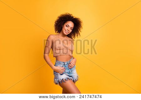 Portrait Of Attractive Charming Cheerful Lovely  Girl With Afro Haidress Dressed In Modern Cool Knit