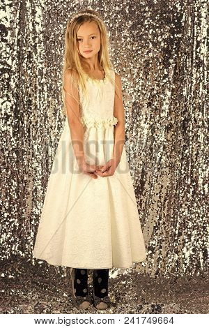 Fashion and beauty, little princess. Little girl in fashionable dress, prom. Fashion model on silver background, beauty. Child girl in stylish glamour dress, elegance. Look, hairdresser, makeup. poster
