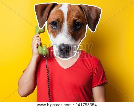 Man With Anthropomorphic Head Of Dog Holding A Handset On Yellow Background