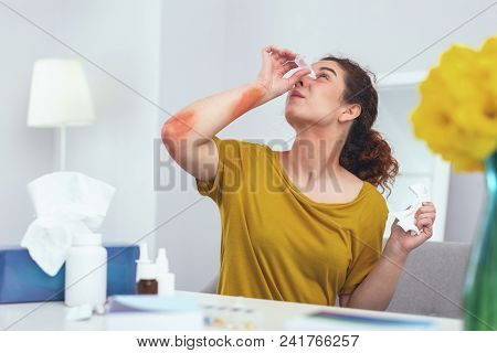 Annoying Allergy. Young Allergic Girl Performing Complex Self Medical Aid While Dealing With Skin Ra