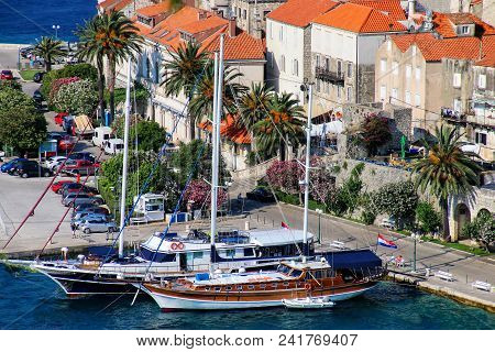Sailboats Anchored At Korcula Old Town, Croatia. Korcula Is A Historic Fortified Town On The Protect
