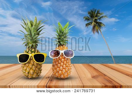 Pineapple On Wooden Table In A Tropical Landscape, Fashion Hipster Pineapple, Bright Summer Color, T