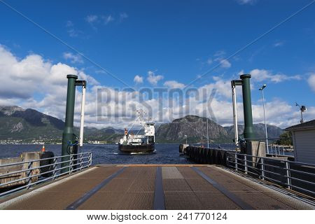 Norway, Lauvvik, July 04, 2017: cargo and passenger ferry in the fjord. View of the route of the Lauvvik - Oanes