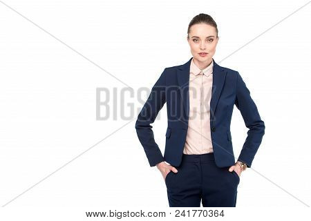 Stylish Adult Businesswoman With Hands In Pockets Looking At Camera Isolated On White