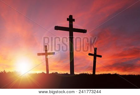 A Silhouette Of The Crucifixion Of Jesus Christ On A Cross With 2 Other Robbers Against A Dramatic S