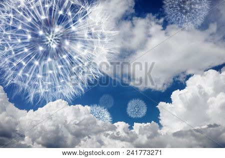 Dandelion Against The Blue Sky In The Clouds. Blowball Fly In The Wind And Symbolize Ease Of Mood An