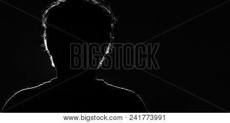 Unknown Male Person Silhouette On Black Background.