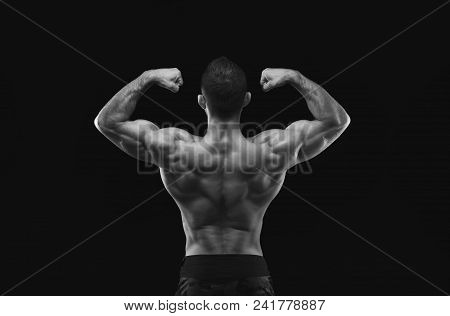 Unrecognizable Man Bodybuilder Shows Strong Hands And Back Muscles, Athletic Trapezius, Studio Shot