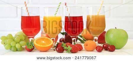 Variety Of Fruit Juices In Four Glasses Orange Juice, Cherry Juice, Mix Juice Of Apple, Apricot, Pea