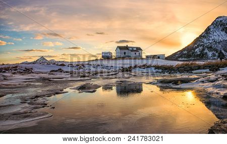 Abandoned House In Lofoten, Norway At Sunset