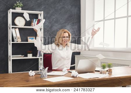 Angry Business Woman Throwing And Tearing Working Documents At Wooden Office Desk, Copy Space