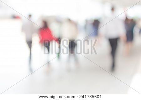 White Blurred Of People Walking In City Town. Defocused Blur Background.