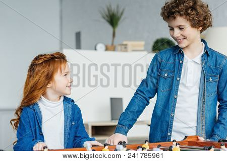 View Of Sister And Brother Playing Foosball Game