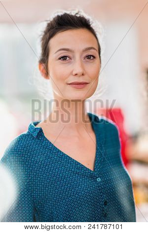 Portrait Of A Beautiful Young Brunette Woman In Her Thirties Looking At The Camera