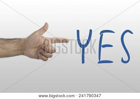 Human Hand Pointing The Word Yes. Approve Concept. Yes Inscription.