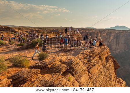 Page, Usa- 02 September, 2017: Tourist At Horseshoe Bend On Colorado River In Glen Canyon In Sunny S