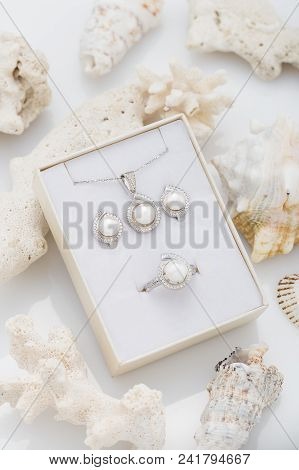 Jewelry Set Of Elegant Silver Earrings, Ring And Pendant Necklace With Pearl And Diamonds In Gift Bo