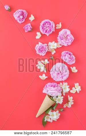 Waffle Cone With Pink Roses And Jasmine Flower Bouquet On Pink Background. Flat Lay, Top View Floral