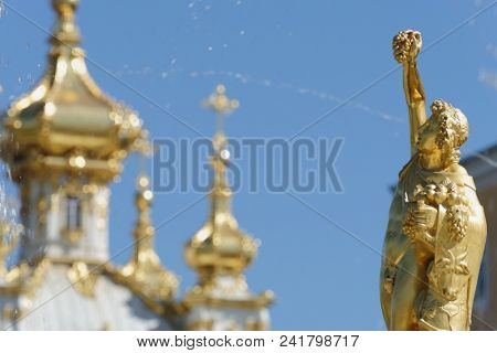 PETERHOF, ST. PETERSBURG, RUSSIA - MAY 10, 2018: Golden statues of the Grand Cascade. The cascade was built in 1715-1724 and is one of the remarkable fountain constructions in the world