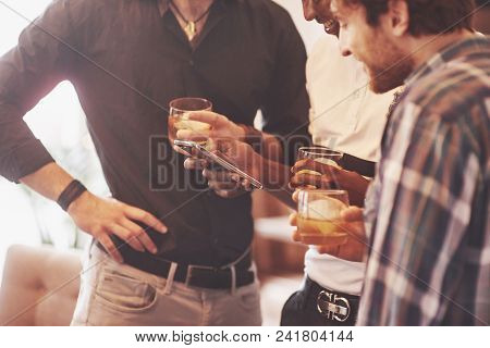 Whiskey. Group Of Multietnic Friends Guys With Glasses Of Whiskey. Concept Party, Bachelor Party Bar