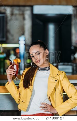 Beautiful Young Woman With Cocktail Spending Time In Bar