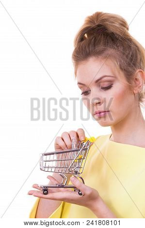 Customer Buying In Shop. Woman Holding Small Tiny Shopping Cart Trolley About To Buy Products.