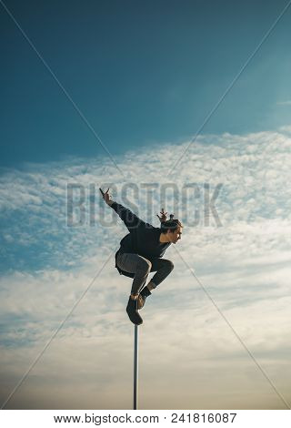 Athletic Guy Make Acrobatic Elements On Pylon. Strong Man Dancer Workout On Pole. Sexy Macho Man Fly