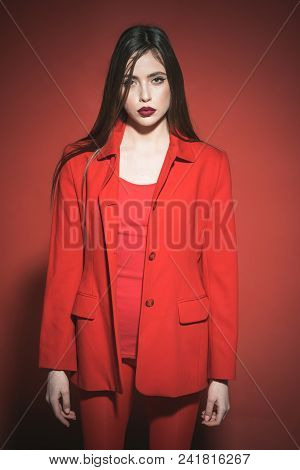Fashion Photo Of A Beautiful Elegant Brunette Girl Isolated On Red Background. Charming Young Woman