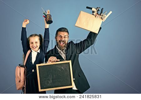 Happy Kid Having Fun. Father And Schoolgirl With Happy Faces On Blue Background, Copy Space. Girl An