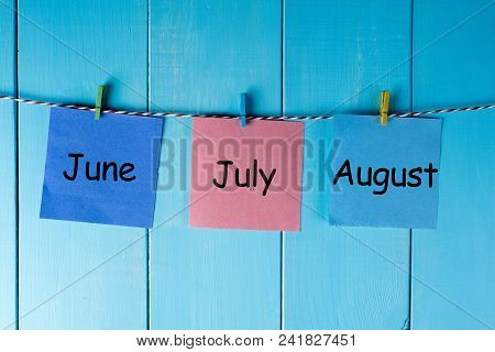 Three Summer Month - June, July And August - On Notes Pinned At Wooden Wall. Summer Calendar Concept