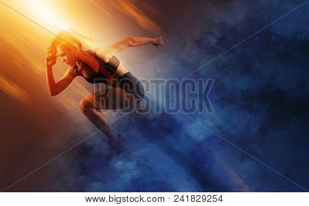 Woman sprinter leaving starting. Exploding start