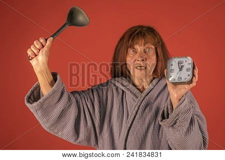 Retirement And Pension. Diner Time, Cooking Or Perfect Morning. Woman With Long Hair Hold Alarm Cloc