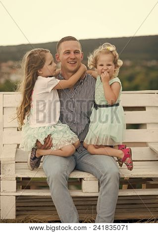 Child Childhood Children Happiness Concept. Father And Daughters Smile On Natural Landscape. Man And