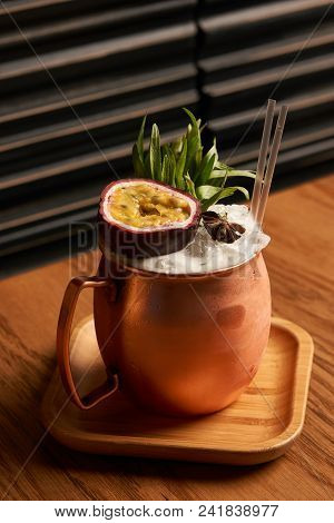 Spicy Mule Cocktail On Bar Table. Alcoholic Beverage Drink With Rum Angostura, Reserve Rum, Dry Oran
