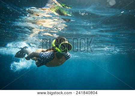 Underwater Photo Of Woman In Diving Mask And Snorkel Diving Alone In Ocean