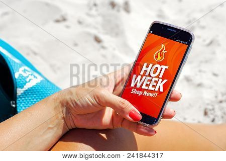 Hot Week Advertising On Cell Phone. Woman On The Beach With A Smartphone In Her Hands. Marketing, Ec