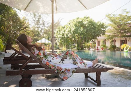 Vietnam woman wearing Ao Dai culture traditional at swimming pool in Mui Ne, Vietnam,vintage style,t