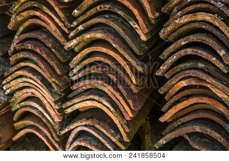 Stacks of old and dirty roof tiles