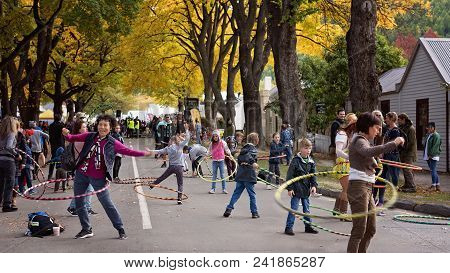 Arrowtown New Zealand Autumn Festival 19th To 25th April 2018 - Tourists With Hula Hoops