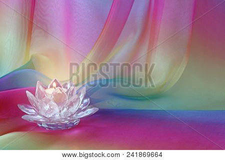Lotus Light Rainbow Chiffon Background - A Lotus Flower Shaped Cut Glass Candle Holder With A Lit Ca