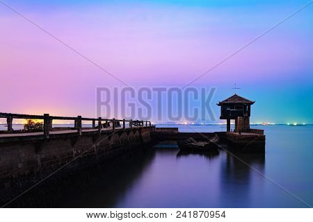 Concrete Bridge To The Sea With Old Wooden House At Pattaya,thailand.