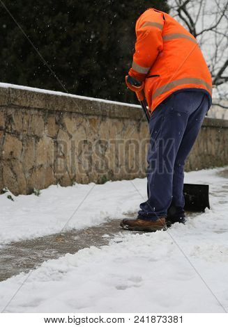 Snow Spreader Shovels The Sidewalks After The Snowfall