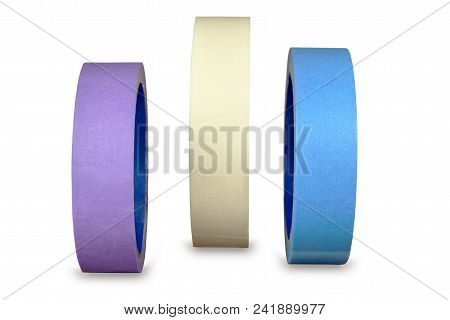 Three Different Color Rolls Of Painting Or Masking Paper Tape,  Isolated On White Background, With C