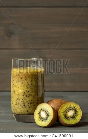 Fresh Smoothies From Kiwi In A Glass And Slices Of Kiwi