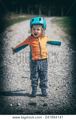 little female child with helmet scream on rural road lomo style picture